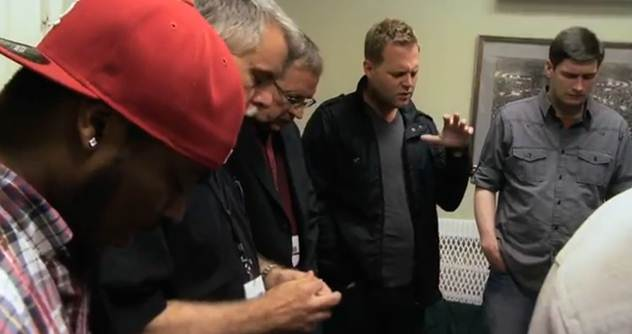Matthew West praying with leadership team at Jersey Shore