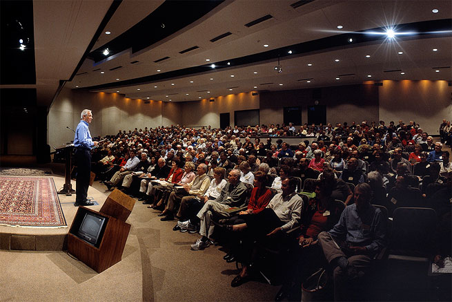 Guests enjoying a seminar in the main auditorium at The Cove.