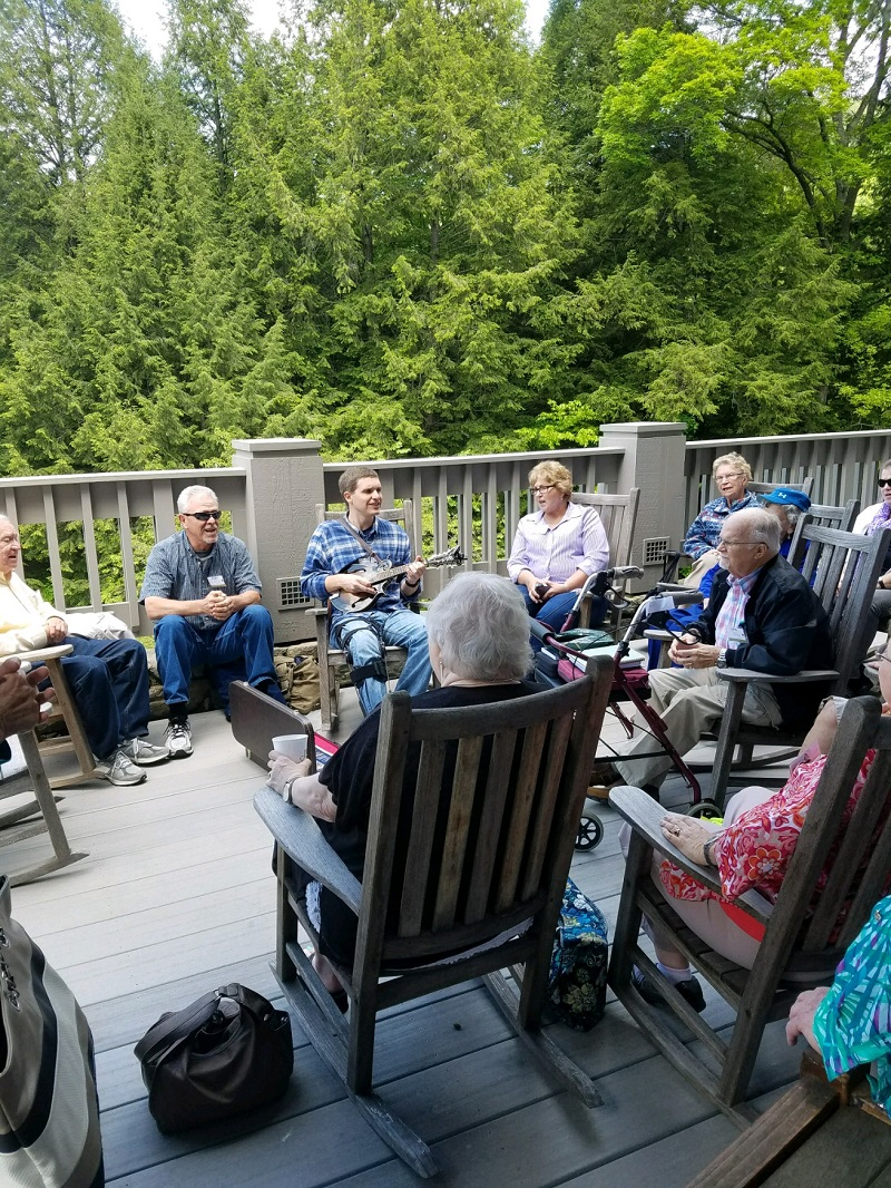 singing and picking on the deck guests from senior celebration May 2017